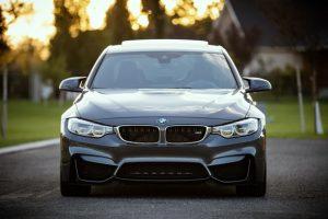 A black luxury BMW sedan.