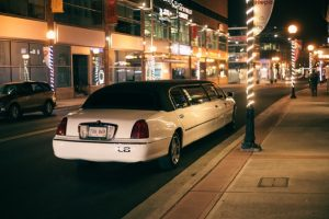A stretch limo parked outside waiting for a client.