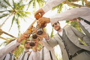 a groom and his best men toasting at a bachelor party