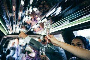 a wedding entourage inside a limousine