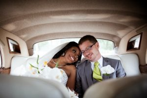 Happily married couple inside a limo rental